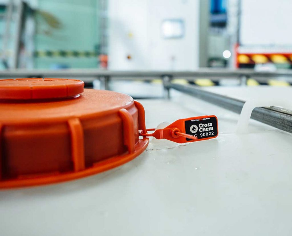 Orange quality seal on a AUS 40 by CrosChem container.
